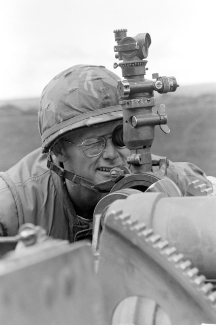 Colonel Henry Radcliffe, commanding officer, 3rd Marine Regiment, sights in a M101 105 mm howitzer during the command readiness exercise Operation ZULU WARRIOR