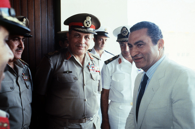 Egyptian President Mohamed Hosni Mubarek with his military aides during BRIGHT STAR '83, the joint U.S. and Egyptian military training exercise. Exact Date Shot Unknown