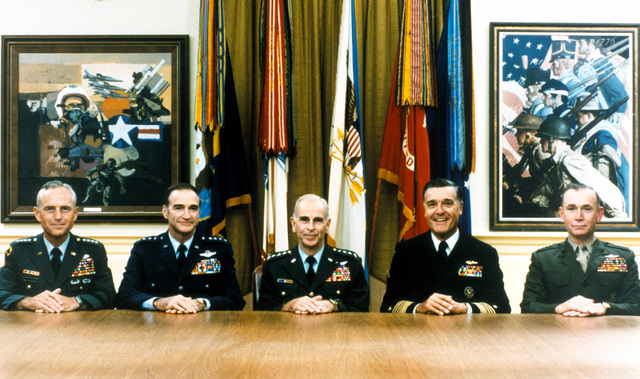 The Joint Chiefs of STAFF (JCS) pose for a protrait in an office at the Pentagon. Seated from left to right are Army CHIEF of STAFF General (GEN) John A. Wickham, Air Force CHIEF of STAFF GEN Charles A. Gabriel, Chairman of the JCS GEN John W. Vessey, CHIEF of Naval Operations Admiral James D. Watkins and Commandant of the Marine Corps GEN Paul X. Kelley