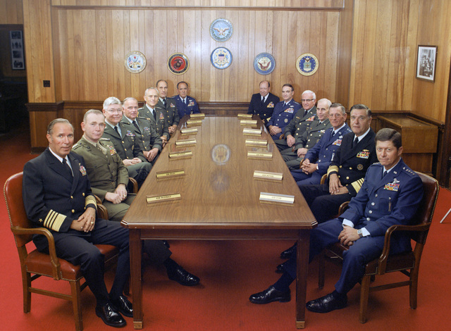 This is a group photograph of the Joint Chiefs of STAFF and several rs in Chiefs taken on July 1, 1983, in the Chairman of the Joint Chiefs of STAFF dining room, located in the Pentagon. Shows (left to right): U.S. Navy Adm. Wesley L. McDonald, r in CHIEF, US Atlantic Command; U.S. Marine Corps GEN. Paul X. Kelley, Commandant of the Marine Corps; U.S. Army GEN. Paul F. Gorman, r in CHIEF, US Southern Command; U.S. Army LT. GEN. Robert C. Kingston, r in CHIEF, US Central Command; U.S. Army GEN. John A. Wickham, CHIEF of STAFF, US Army; U.S. Army GEN. Wallace H. Nutting, r in CHIEF, US Readiness Command; U.S. Air Force GEN. James V. Hartinger,...