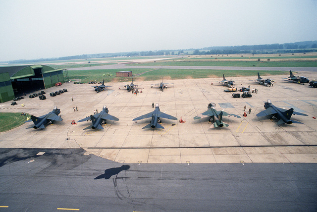 A-7 Corsair II aircraft are parked on the flight line as members of the 112th Tactical Fighter Group, Air National Guard, Pittsburgh, Pennsylvania, and the 150th Tactical Fighter Group, New Mexico Air National Guard, perform preflight maintenance during Exercise CHECKERED FLAG