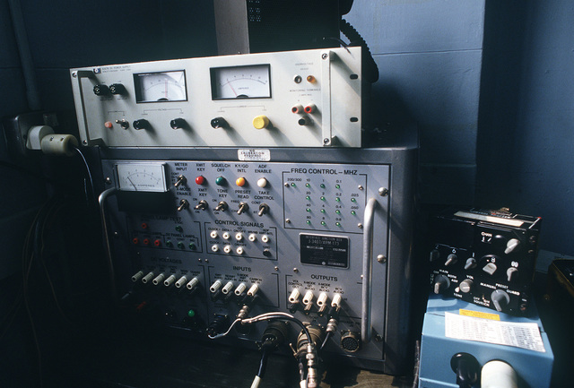 A J-3407/ARM-173 interface junction box and Hewlett-Packard 6267B DC power supply in use during Exercise CHECKERED FLAG