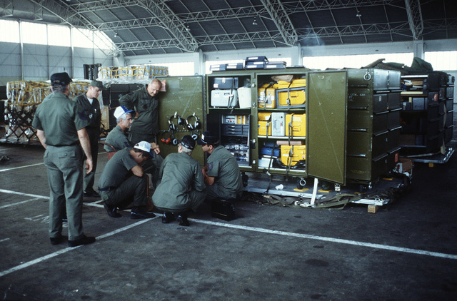Air National Guard personnel conduct an inventory of equipment inside the maintenance hangar during Exercise CHECKERED FLAG