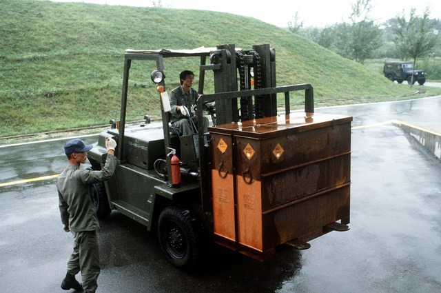 Korean troops use a forklift to remove crates of 30mm munitions from an open flatrack container. The container, shipped to South Korea from the Seneca Army Depot, California, is being tested by the Air Force as an alternative to the military owned demountable container (MILVAN)