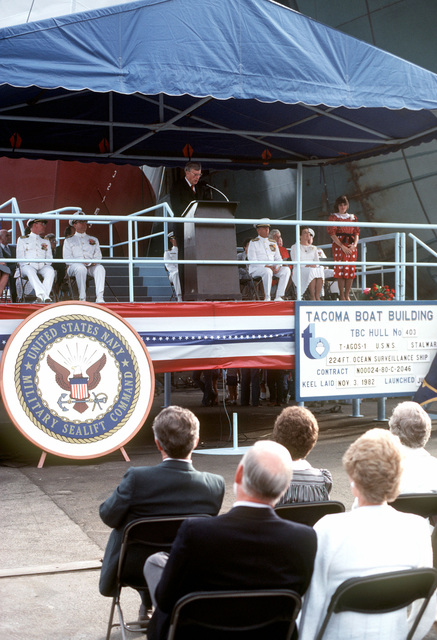 Frank B. Lynott, Chairman of the Tacoma Boat Building Company and master of ceremonies, introduces Patricia L. Zech, maid of honor and daughter of Vice Admiral Lando W. Zech Jr., during the launching ceremony for the ocean surveillance ship USNS STALWART (T-AGOS 1)