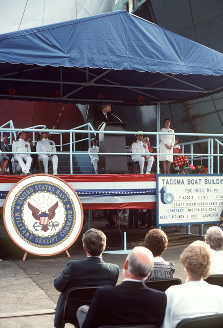 Frank B. Lynott, Chairman of the Tacoma Boat Building Company and master of ceremonies, introduces Josephine Kerr Zech, sponsor and wife of Vice Admiral Lando W. Zech Jr., during the launching ceremony for the ocean surveillance ship USNS STALWART (T-AGOS 1)