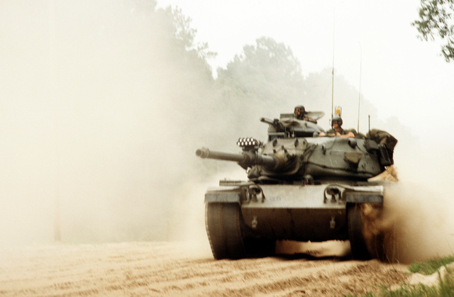 A Mulitple Intergrated Laser Engagement System (MILES) equipped M-60A3 main battle tank of the 1ST Battalion, 108th Armor, 48th Brigade, Georgia National Guard, moves out during an exercise. The unit is preparing for its annual training exercise to be held this year at Fort Irwin, California. (SUBSTANDARD)