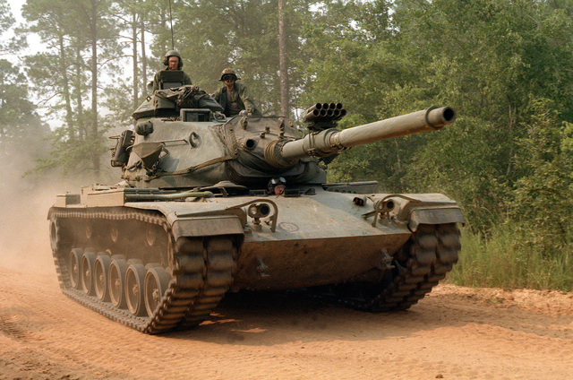 An M60A3 main battle tank from the 1ST Platoon, 48th Brigade, 108th Armored Division, Georgia National Guard, moves through a recently cleared roadblock during the training exercise Company Team Defense