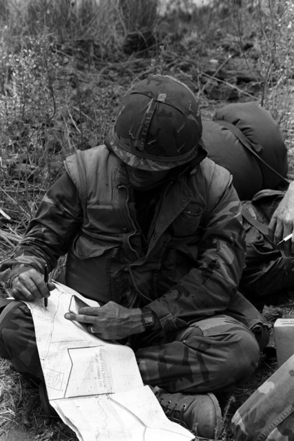 Lieutenant Barber from Company E, 2nd Battalion, 3rd Marine Regiment, 1ST Marine Brigade, briefs his squad leader on up-coming tactics during Operation ZULU WARRIOR. The operation is taking place at the Pakalula Training Area