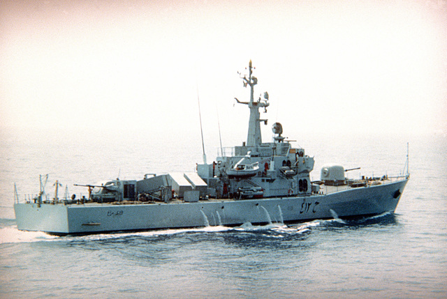 """A starboard quarter view of the Libyan """"Assad"""" class missile corvette """"Assad Al Tadjier"""" underway. The ship is fitted with four Otomat anti-shipping missiles, one 76mm OTO Melara cannon and a twin 35mm Oerlikon/OTO Melara turret aft"""