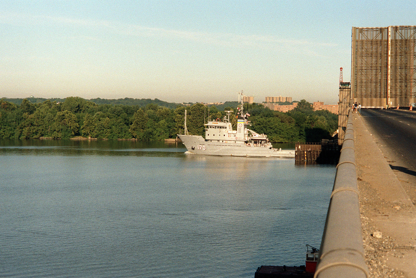 A port beam view of the fleet tug USNS MOHAWK (T-ATF-170) as it passes through the draw of the Woodrow Wilson Bridge, after a week-long port visit to the Washington Navy Yard