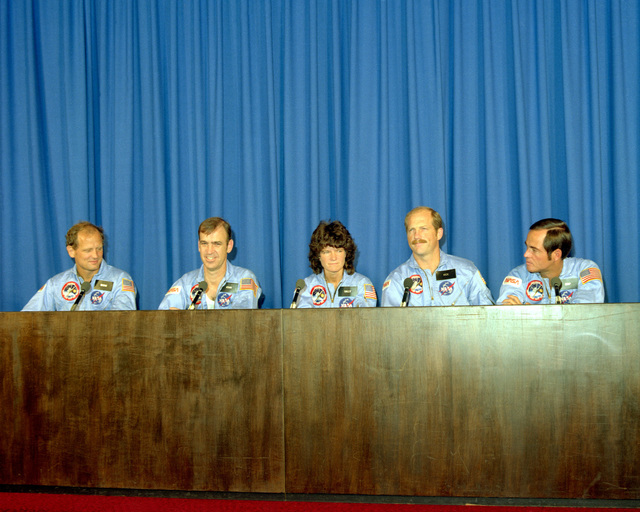 Space shuttle Challenger astronauts attend a press conference upon their return from space after completing Space Transportation System Mission 7 (STS-7). They are, left to right, Mission Specialists Dr. Norman Thagard, John Fabian and Dr. Sally Ride; Frederick Hauck, pilot, and Robert Crippen, commander. Ride is the first American woman astronaut to fly in space