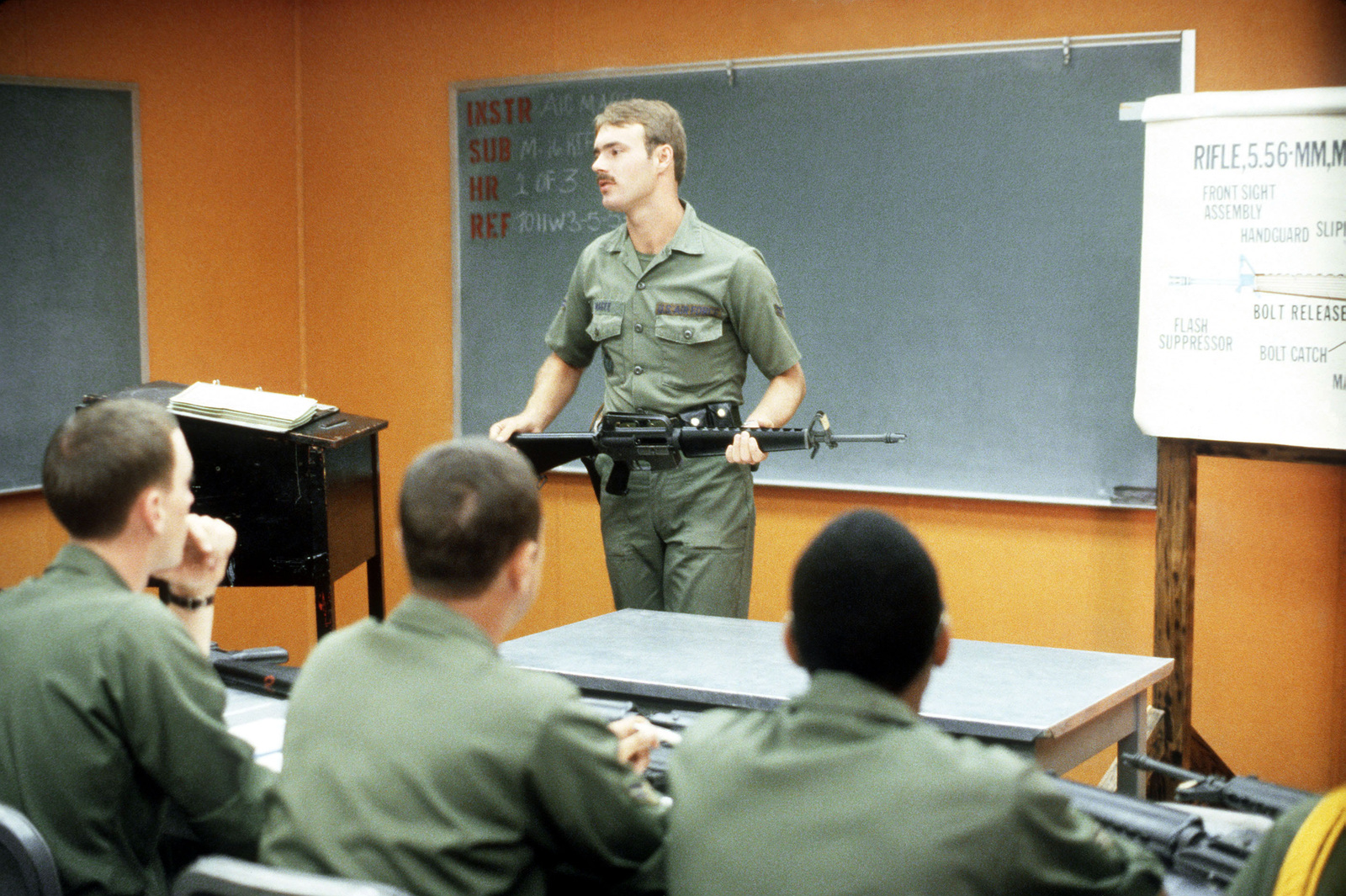 Members of the 90th Security Police Group listen to a
