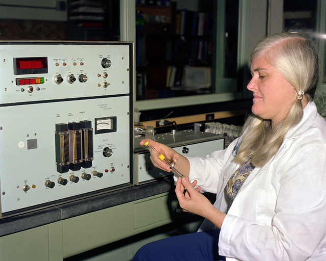 A female chemist conducts a test at the U.S. Army Mobility Equipment Research and Development Command Energy and Water Resources Laboratory