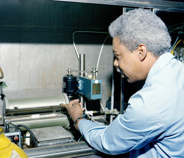 A research chemist monitors test equipment at the U.S. Army Mobility Equipment Research and Development Command Electrical Power Laboratory