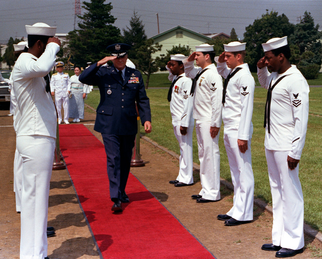 Lieutenant General Charles L. Donnelly, Commander of United States forces in Japan and the 5th Air Force, arrives at the change of command ceremony for Fleet Air, Western Pacific (COMFAIRWESTPAC). Commodore Willis I. Lewis Jr. assumes command of COMFAIRWESTPAC from Rear Admiral James W. Austin