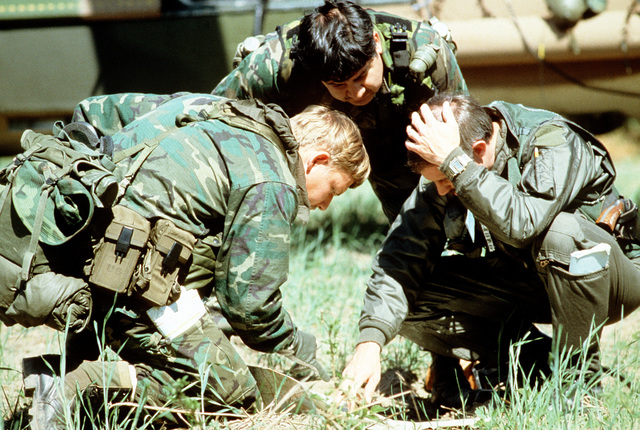 Reservists discuss resuce plans during Condor CRTE '82, a combat rescue exercise designed to give reservists battlefield experience
