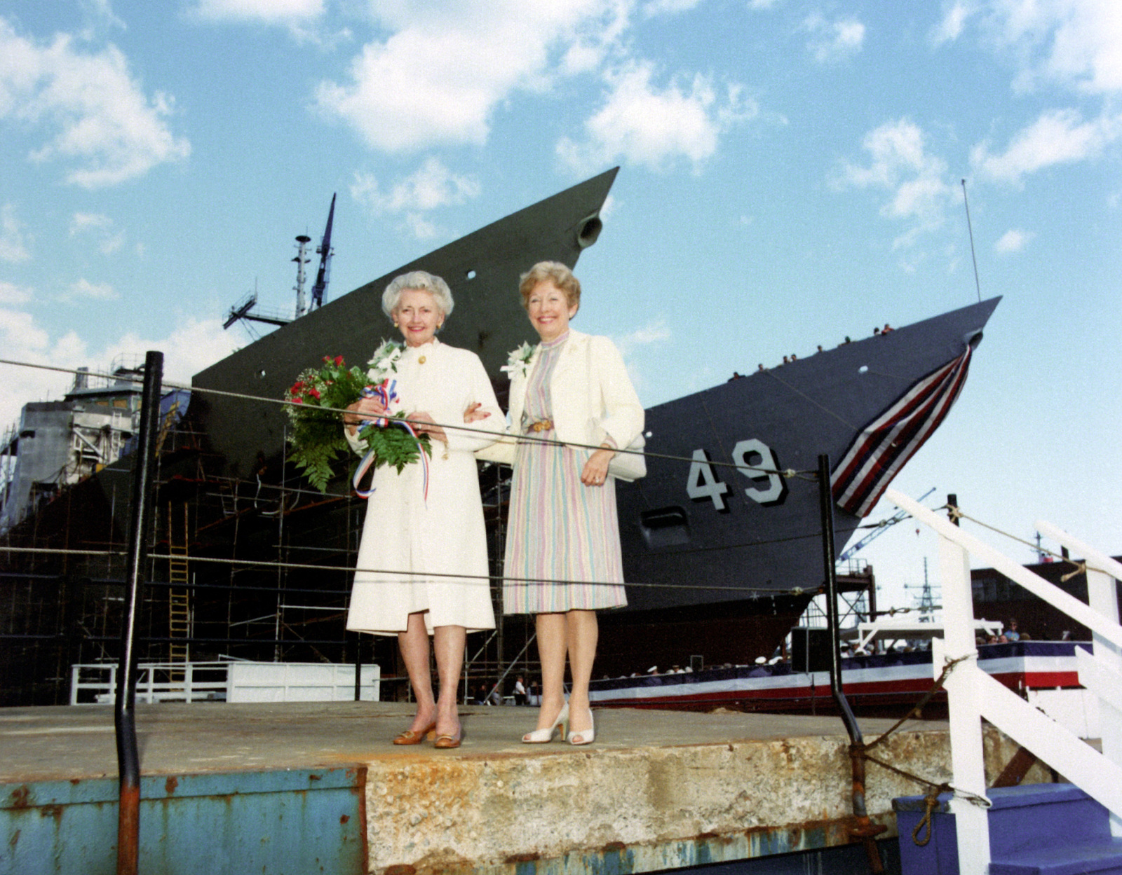 Edna D. Woodruff, left, sponsor of the guded missile frigate ROBERT G. BRADLEY (FFG-49) and Sybil Godfrey Geiger, matron of honor, stand near the ship's bow during the launching ceremony