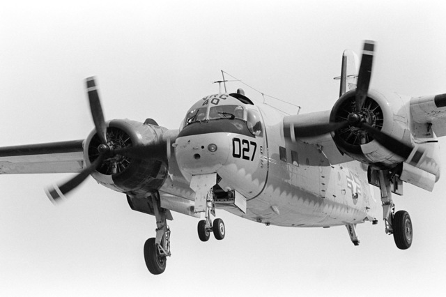 A left front view of a C-1A Trader aircraft from Fleet Logistics Support Squadron 40 (VRC-40) as it approaches to land