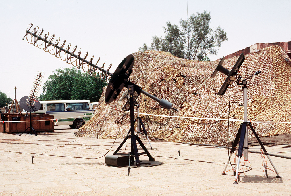 A view of communications equipment set up in the Sudanese air force area during Arid Farmar, a deployment made in response to Libyan activities in Chad. Camouflage netting is being used to conceal part of the operation