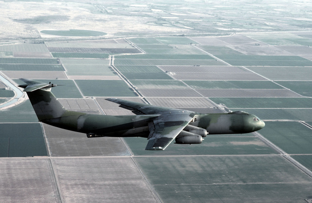 An air-to-air right side view of a C-141B Starlifter aircraft, with the new Euro-1 paint scheme, during a practice mission for Volant Rodeo '83