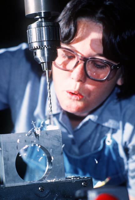 Machinery Repairman 2nd Class (MR2) Debra Walton works on a brace at the Trident Refit Facility