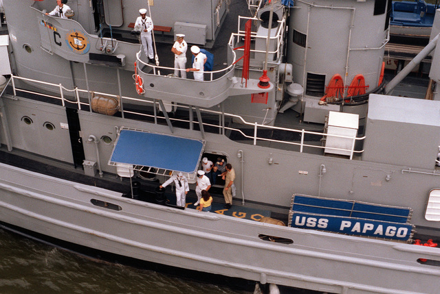 A port side view of the upper decks of the fleet tug USS PAPAGO (ATF-160), passing through the draw of the Frederick Douglas Bridge after a port visit to Washington Navy Yard