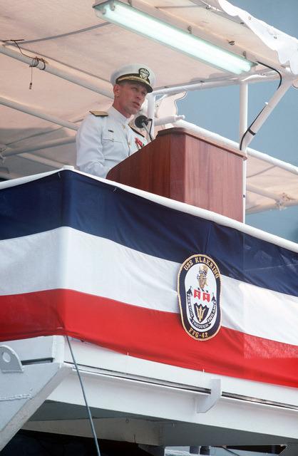 Rear Admiral George W. Davis Jr., deputy commander, Surface Ships, Naval Sea Systems Command, speaks during the commissioning of the guided missile frigate USS KLAKRING (FFG 42)