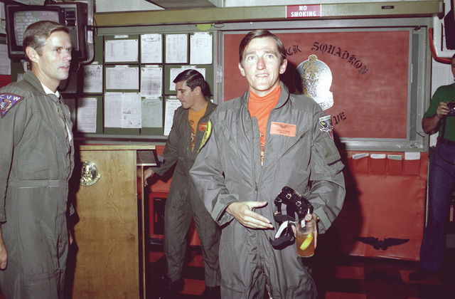 Secretary of the Navy John F. Lehman Jr. attends a preflight briefing in the ready room of Attack Squadron 65 (VA-65) aboard the nuclear-powered aircraft carrier USS DWIGHT D. EISENHOWER (CVN-69)