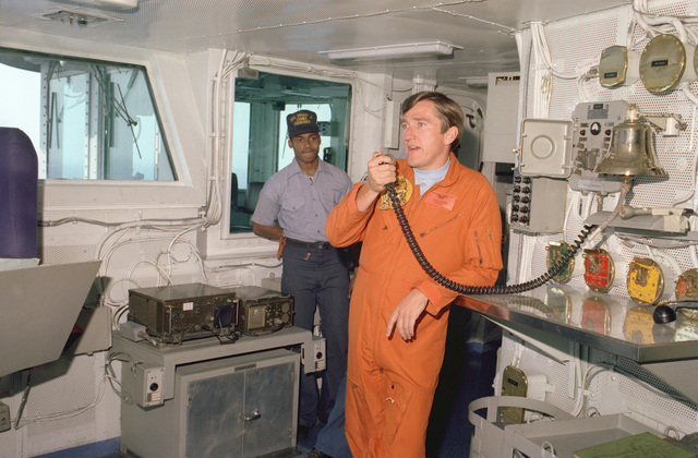 Secretary of the Navy John F. Lehman Jr. speaks to the crew by intercom from the bridge of thenuclear-powered aircraft carrier USS DWIGHT D. EISENHOWER (CVN-69)