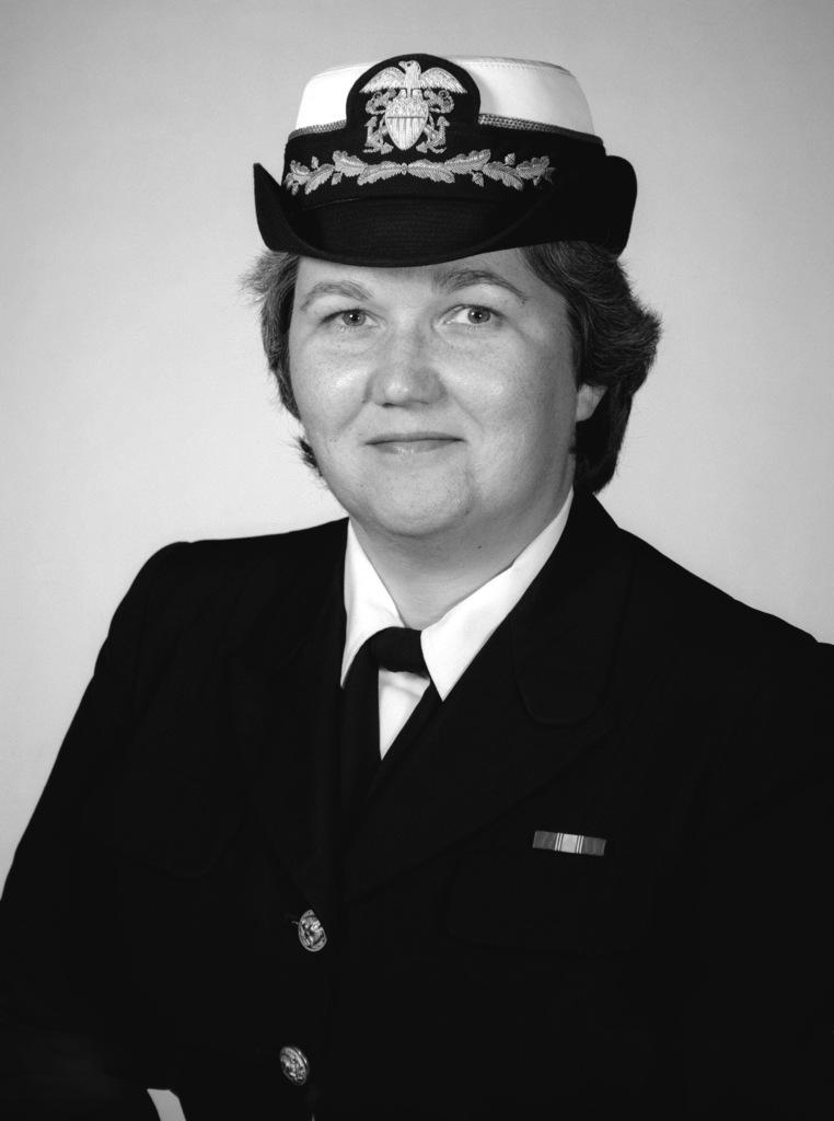 Commander Kathryn J. Corral, USN (covered)