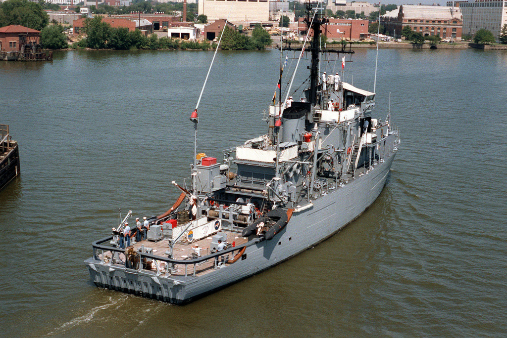 A starboard quarter view of the ocean minesweeper USS Fidelity (MSO-443), passing through the draw of the Frederick Douglas Bridge en route to the Washington Navy Yard for a port visit
