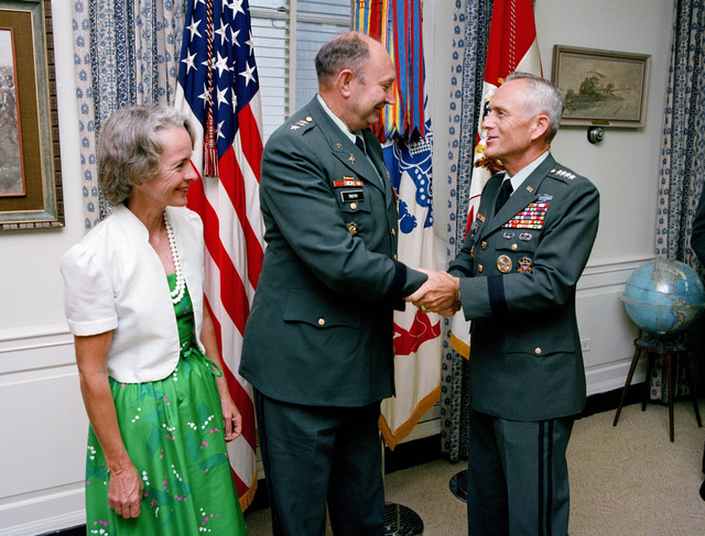 General (GEN) John A. Wickham Jr., Army chief of staff, congratulates Lieutenant General (LGEN) Richard D. Trefry, Army inspector general, after presenting him with the Distinguished Service Medal during his retirement ceremony at the Pentagon.  Looking on is Mrs. Trefry