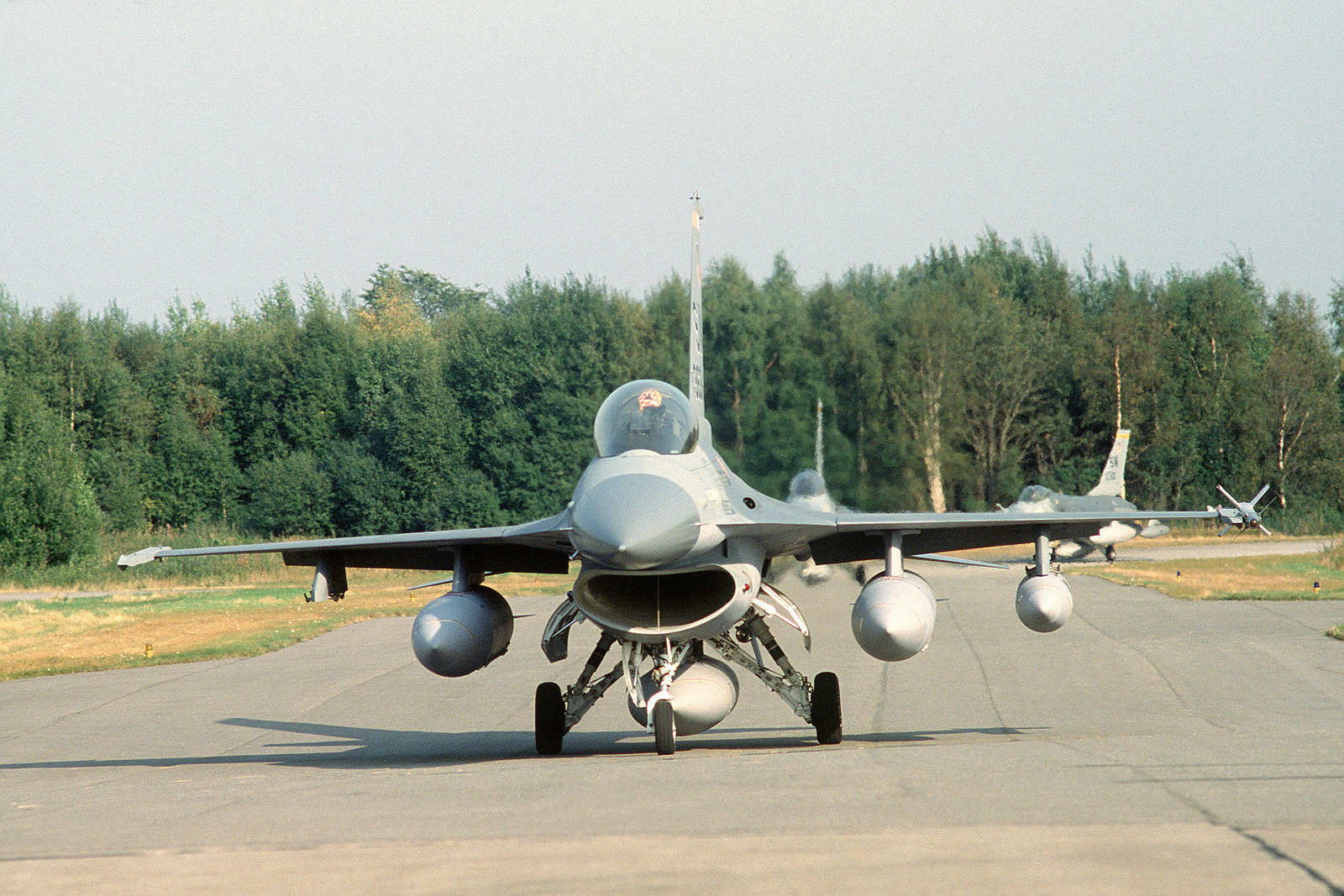 A left front view of F-16 Fighting Falcon aircraft as they taxi out