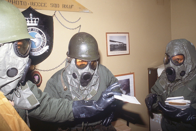 Members of the 19th Tactical Fighter Squadron, wearing an M-17 chemical-biological field masks, participate in a nuclear biological chemical (NBC) warfare exercise during CORNET GAUNTLET '83