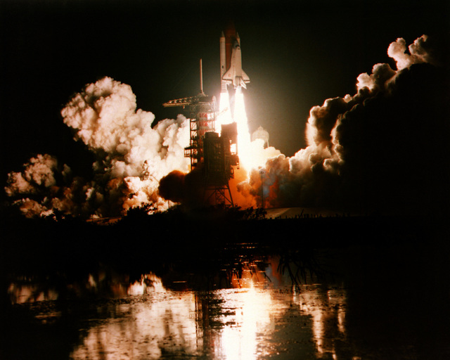 The space shuttle orbiter Challenger lifts off from Complex 39 during the first night launch of the Space Transportation System (STS). Aboard for the mission (STS-8) are: Richard Truly, commander; Daniel Brardenstein, pilot; and mission specialists Dale G