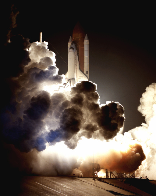 The space shuttle orbiter Challenger (STS-8) lifts off from Pad A, complex 39 at 2:32 am EDT for the first night launch of the Space Transportation System. the STS-8 mission will conclude wih a nighttime landing at Edwards Air Force Base, California
