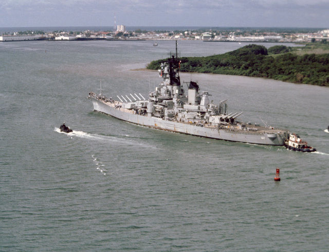 An aerial port bow quarter view of the battleship USS NEW JERSEY (BB 62) passing Colon after transitting the Panama Canal on its way to the Mediterranean Sea