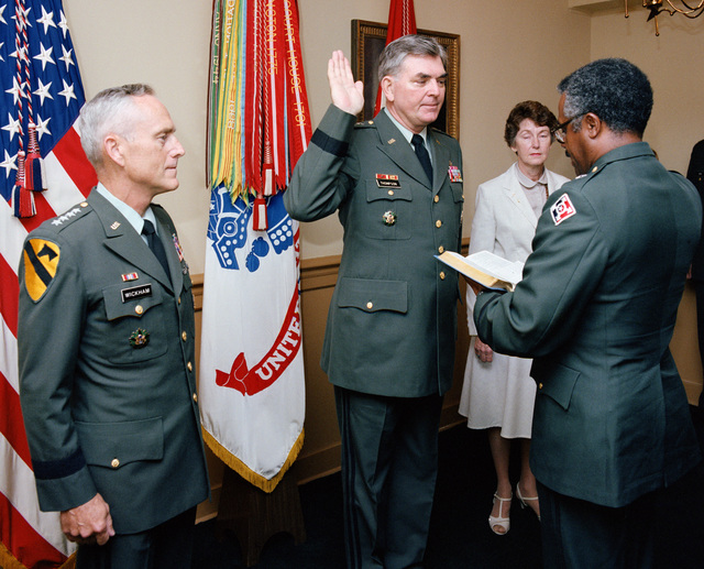 Brigadier General (BGEN) Donald J. Delando, deputy adjutant general, US Army, gives the oath of office to Lieutenant General Nathaniel R. Thompson Jr., who is becoming Army inspector general.  On the left is General (GEN) John A. Wickham Jr., Army chief of staff