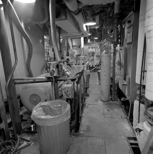 The lower level engine room aboard the guided missile frigate NICHOLAS (FFG-47). The ship is 80 percent complete