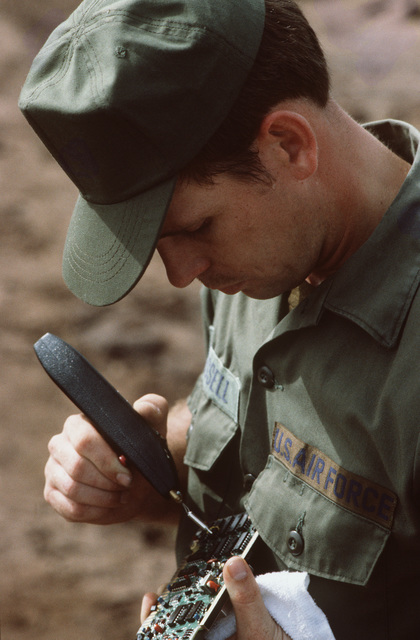 An electronics specialist solders a circut to a circut board at the 41st Combat Support Hospital during the Ahuas Tara II training exercise