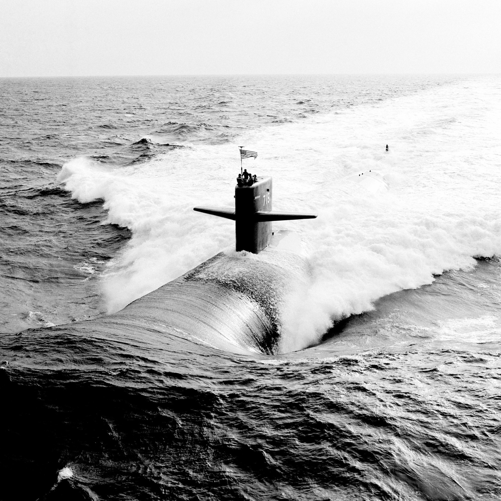 An aerial port bow view of the Los Angeles class nuclear-powered attack submarine USS BUFFALO (SSN 715) underway