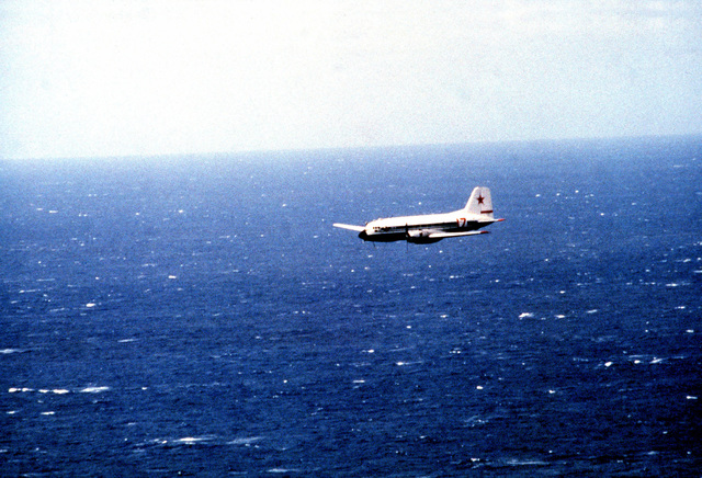 An air-to-air left side view of a Soviet I1-14 Crate aircraft involved in the search and rescue operations for the downed Korean Airlines 747 (KAL-007). KAL-007 was shot down by a Soviet aircraft when it was suspected of being a surveillance mission over Sakhalin Island