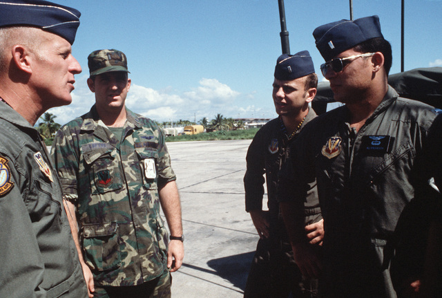 Lieutenant Colonel Jim L. Ridenour, left, commander, 24th Composite Squadron, briefs O-2A aircraft pilots on the day's flight schedule during the AHUAS TARA II (BIG PINE) training exercise