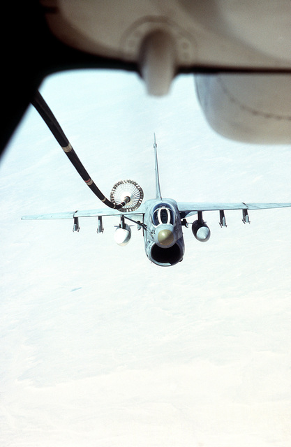 An A-7 Corsair II aircraft approaches to link-up to the fuel hose from a KC-10 Extender aircraft, for in-flight refueling during the joint Exercise BRIGHT STAR '83