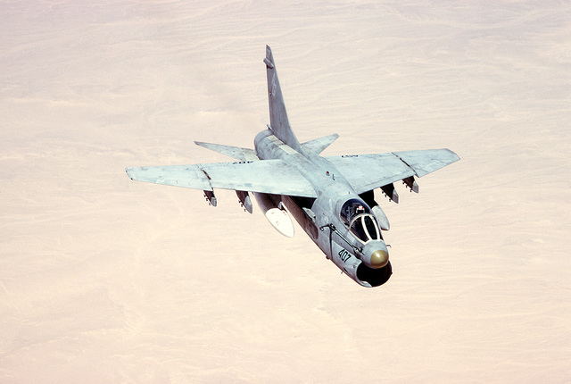 An air-to-air right front view of an A-7 Corsair II aircraft in use during the joint Exercise Bright Star '83