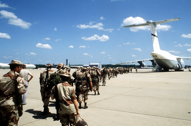 Army troops line up to board a C-5A Galaxy aircraft that will take them to Southwest Asia for participation in Bright Star '83