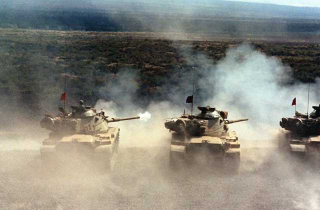 M-60A1 Reliability Improved System Equipment (RISE) main battle tanks of A Troop, 3rd Squadron, 4th Cavarly, 25th Infantry Division, fire their guns during a live-fire training exercise on the tank range. (Substandard image)