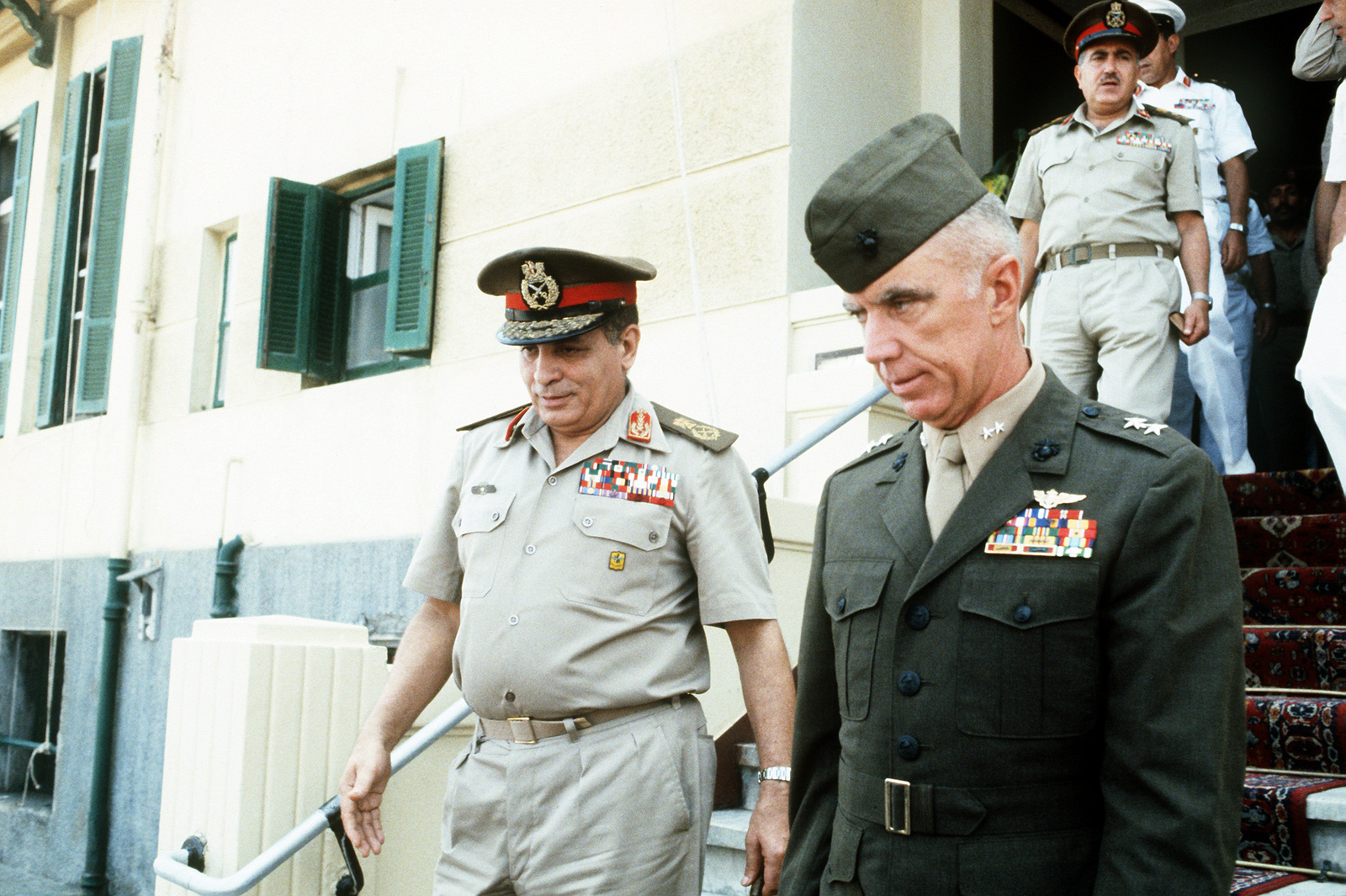 Marine MAJ. GEN. Jacob W. Moore of the U.S. Central Command, exits a building with Egyptian officers during the joint Exercise Bright Star '83