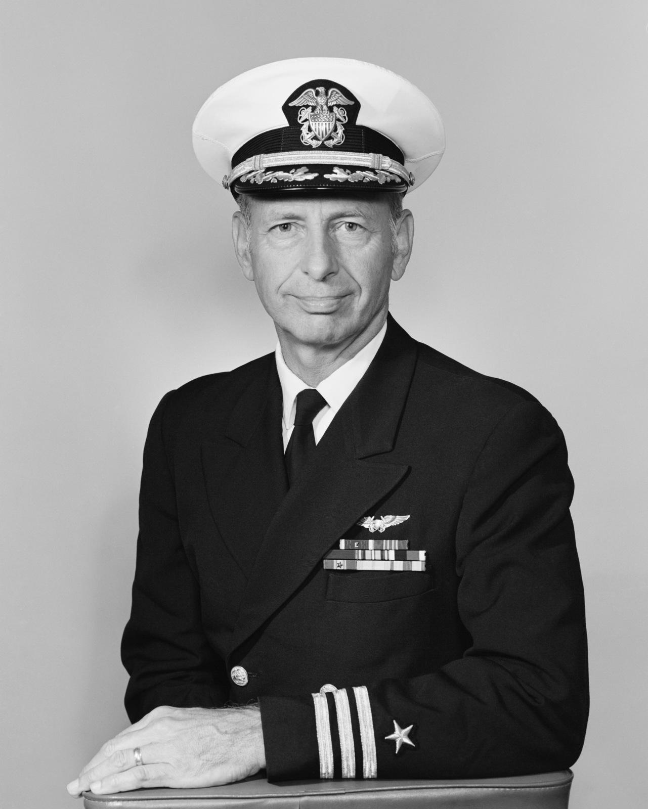 Commander Andre Marechal, USN (covered)